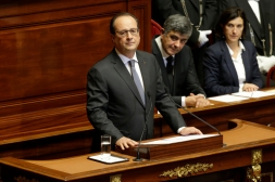 French President Francois Hollande reacts as he delivers a speech at a special congress of the joint upper and lower houses of parliament at the Palace of Versailles, near Paris